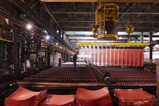 A worker removes pure copper cathodes from electrolytic baths at the KGHM Polska Miedz SA copper smelting plant in Glogow, Poland, on Tuesday, March 9, 2021. Image: Bloomberg