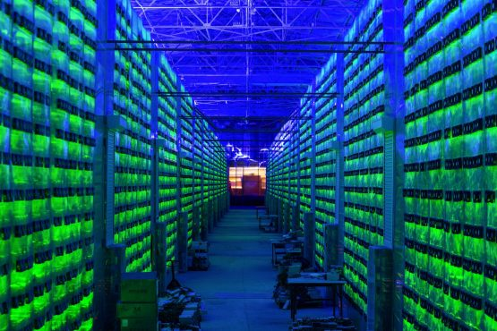 Illuminated mining rigs operate inside racks at the CryptoUniverse cryptocurrency mining farm in Nadvoitsy, Russia, on Thursday, March 18, 2021. The rise of Bitcoin and other cryptocurrencies has prompted the greatest push yet among central banks to develop their own digital currencies. Image: Andrey Rudakov/Bloomberg