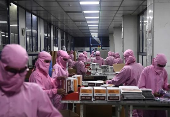 Workers pack syringes at India's biggest syringe manufacturer. Government support has been key to developing this capacity. Image: by Sajjad Hussain/AFP via Getty Images