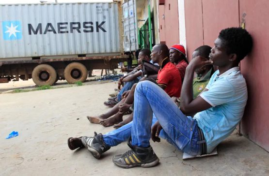 Image: Unemployed Liberian young men seeking daily jobs at the industrial district of Bushrod Island, Monrovia, Liberia. EFE-EPA/Ahmed Jallanzo
