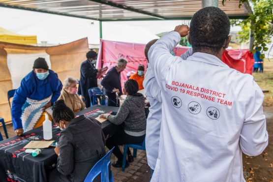 Residents register for the Covid-19 vaccination programme outside the Bonang Community Health Centre in Brits. Image: Waldo Swiegers, Bloomberg