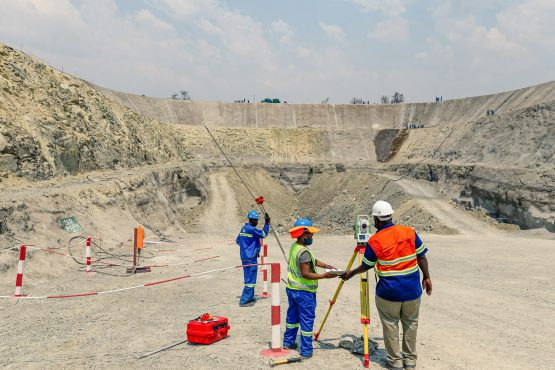 Workers survey the Portal One area of the Great Dyke Investments Darwendale platinum mine project, near Harare, Zimbabwe. Image: