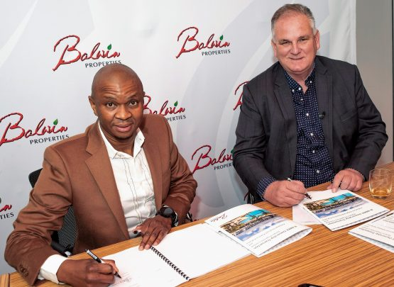 Steve Brookes, founder and CEO of JSE-listed Balwin Properties, right, with Aobakwe Reginald Kukama at the signing of the empowerment deal in Bedfordview on Wednesday, 26 May, 2021. Image: Supplied