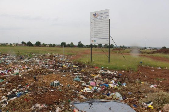 The site for a clinic in New Eersterust, Hammanskraal, Pretoria, is now used as a dump, after the project came to a halt in 2019. Image: GroundUp