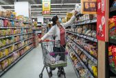 After years in prison, China grocery tycoon weighs twin IPOs