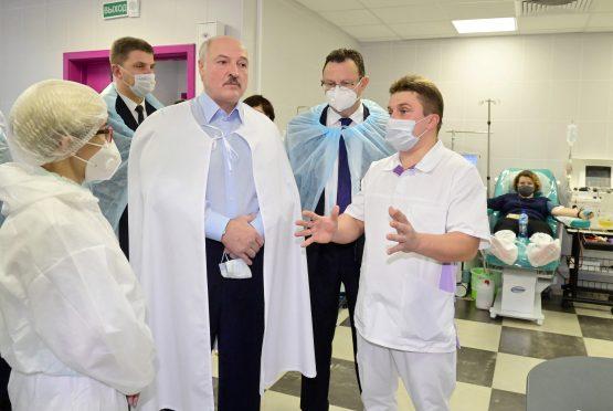 Belarus President Alexander Lukashenko visits a hospital for Covid-19 patients, unmasked, in Minsk on November 27, 2020. Image: Andrei Stasevich\TASS via Getty Images