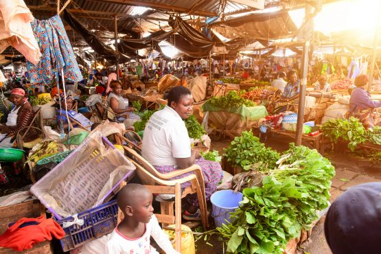 Vendors sell fruits and vegetables at an informal food market. Image: Billy Miaron/Shutterstock