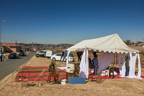 Workers from Vuyo's Funerals set up a ceremony marquee in Soweto. Image: Waldo Swiegers/Bloomberg
