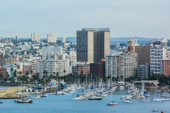 Residential and commercial buildings stand on the skyline by the harbour at the Port of Durban. Image: Bloomberg