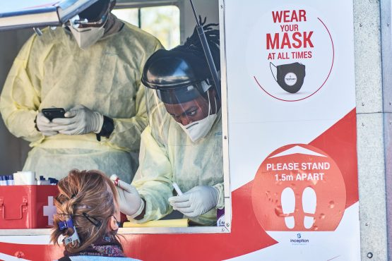 A health worker administers a nasal swab at a Testaro Covid-19 mobile testing site in Sandton. Image: Waldo Swiegers, Bloomberg