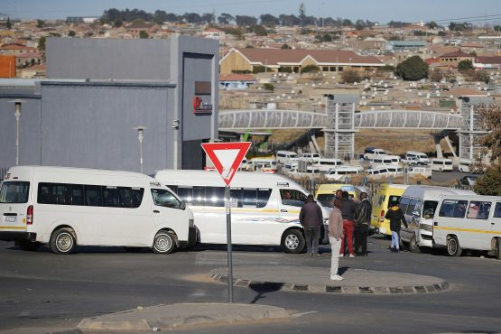 Taxi drivers block the entrance to Birch Acres Mall in Tembisa, north of Johannesburg on July 14. Image: Phill Magakoe, AFP/Getty Images