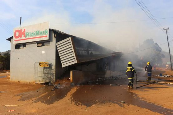Firefighters extinguish a fire at a supermarket in Manzini, Eswatini, on June 30, 2021. Image: Bloomberg