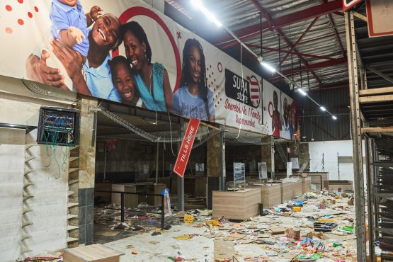 Debris inside a badly damaged supermarket following rioting in Soweto on July 15. Image: Waldo Swiegers, Bloomberg