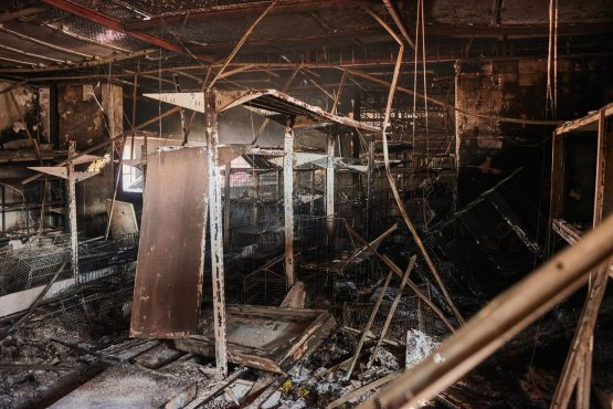 A burnt-out grocery store following rioting in Soweto on July 15. Image: Waldo Swiegers/Bloomberg