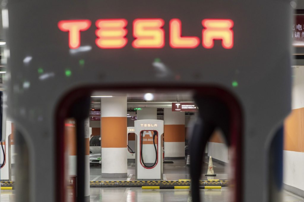 Tesla shares set to touch new record as good news piles up
