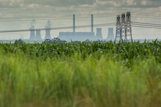 Electricity transmission pylons near the Komati coal-fired power station, operated by Eskom in Mpumalanga. Image: Bloomberg