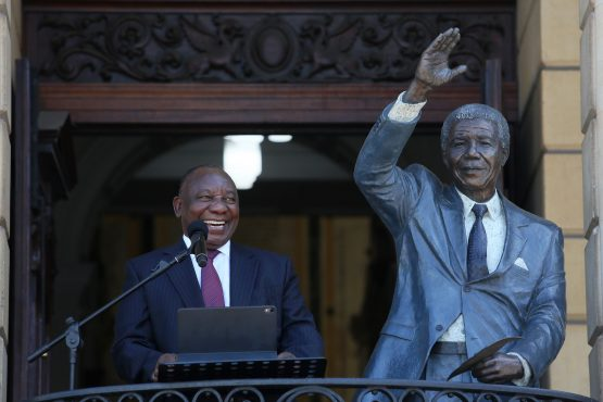 South African president Cyril Ramaphosa delivers a speech next to a statue of the late former president Nelson Mandela in Cape Town in 2020. EPA-EFE/Ruvan Boshoff