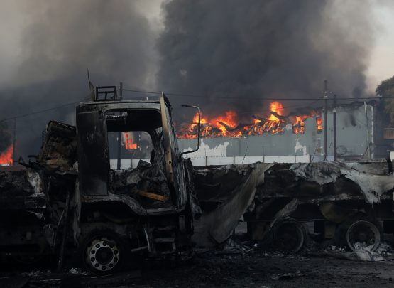 Trucks and business were looted and burnt during recent riots in South Africa. EPA-EFE/Stringer