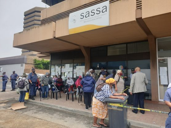 Queues at a South African Social Security Agency office in Bellville in January. The reinstatement of the Covid-19 grant takes the country one step closer to a universal basic income guarantee, say the authors. Image: Mary-Anne Gontsana