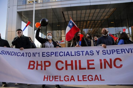 Workers of the Escondida copper mine protest during a strike outside BHP Billiton's offices, in Santiago, on May 27, 2021. Image: Javier Torres/AFP/Getty Images