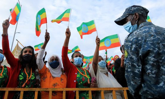 Women hold national flags during a rally to support the National Defense Force and to condemn the expansion of the Tigray People Liberation Front (TPLF) fighters into Amhara and Afar regional territories at the Meskel Square in Addis Ababa, Ethiopia August 8, 2021. Image: Tiksa Negeri, Reuters