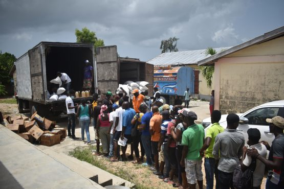 Residents wait in line to receive food aid in Port-Salut, Haiti. Bloomberg