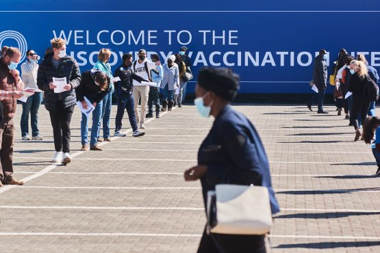 Residents wait in line to register at a Discovery mass vaccination site in Midrand. Image: Bloomberg