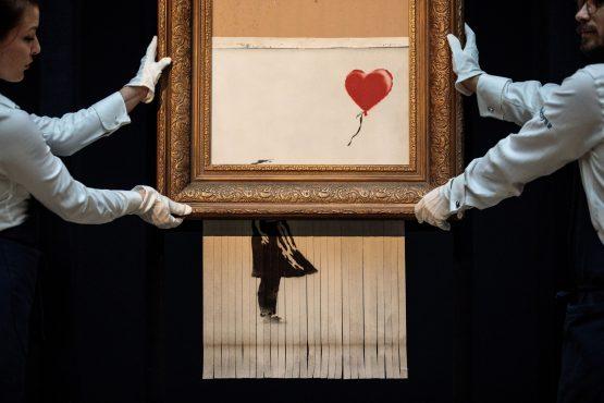 'Love is in the Bin' by British artist Banksy.  Image: Bloomberg