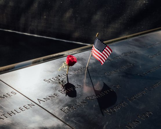 The names of those killed in the 2001 and 1993 terrorist attacks on the World Trade Center inscribed on bronze parapets edging the memorial pools at the National September 11 Memorial & Museum in New York.: George Etheredge, Bloomberg