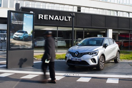 A Renault Espace Initiale SUV beside an advertisement for a Renault Twingo electric automobile at a Renault SA showroom in Paris, France, on Wednesday, April 21, 2021. Image: Nathan Laine/Bloomberg