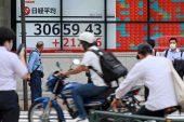 Stocks mixed, bonds slip as traders mull recovery: markets wrap