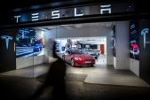 Tesla shares reach new heights as earnings supercharge rally