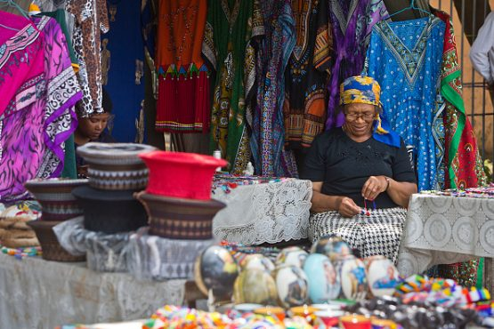 A woman running her stall on Vilakazi Street, Orlando West. Soweto, Johannesburg. Image: Hoberman Collection/Universal Images Group via Getty Images