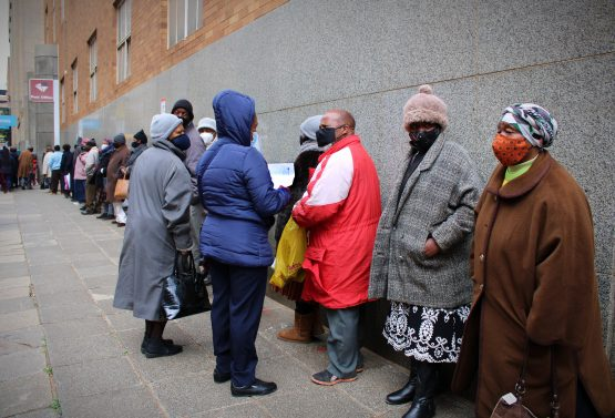 Pensioners stand in line outside Marshalltown Post Office to collect their grants. Image: Masego Mafata.